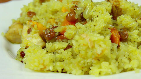 Fresh and hot pilaf in plate, dolly shot, close-up Stock Video Footage