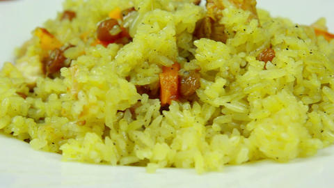 Fresh and hot pilaf in plate, dolly shot, close-up Footage