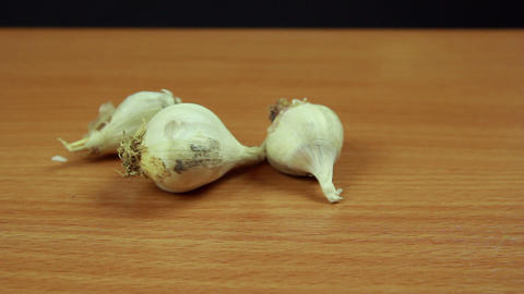 Onions And Garlic On Wooden Table Dolly Shot stock footage