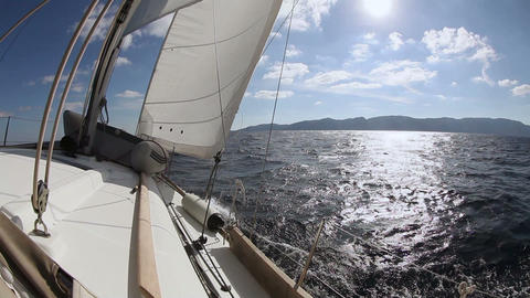 Sailing yacht on the race in blue sea Stock Video Footage