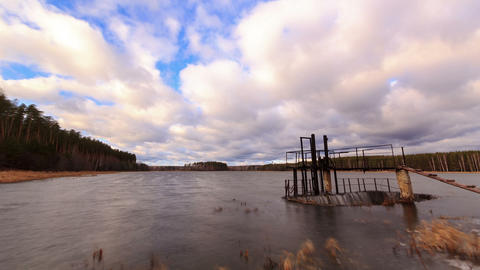 Dam on the background of clouds. Time Lapse Footage