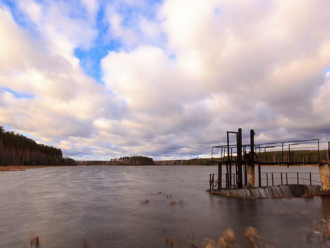 Dam on the background of clouds. Time Lapse Live Action