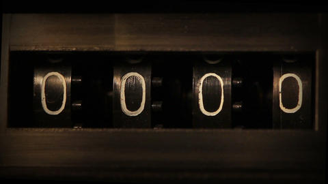 old mechanical counter counts numbers - macro Stock Video Footage