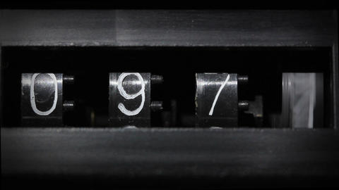 old mechanical counter counts numbers Stock Video Footage
