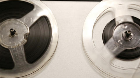 Old Reel Tape Recorder With Spinning Reels - Dolly stock footage