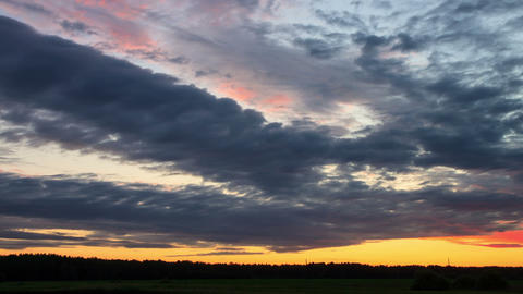 Cloud melts at sunset. Time Lapse Stock Video Footage