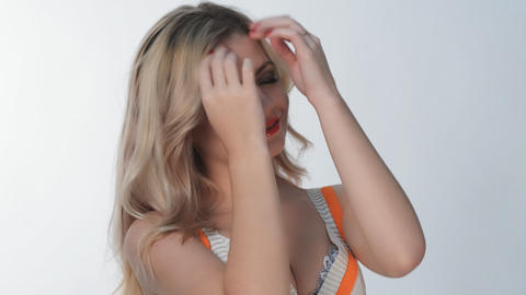 Young blond girl posing in studio Stock Video Footage