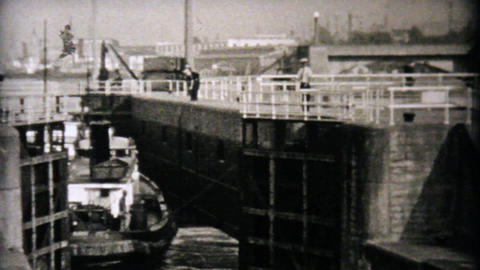 Boat Going Through Locks In Seattle 1940 Vintage Stock Video Footage