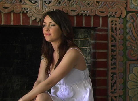 Beautiful Girl Sitting at a Fireplace (3) Stock Video Footage