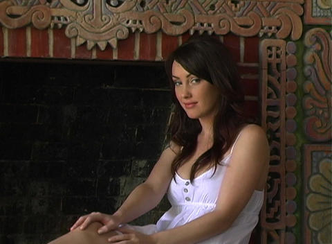 Beautiful Girl Sitting at a Fireplace (3) Footage
