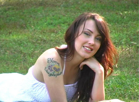 Beautiful Brunette Lying in the Grass (2) Footage
