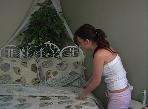 Beautiful, Sexy Brunette Makes Her Bed (3) Stock Video Footage
