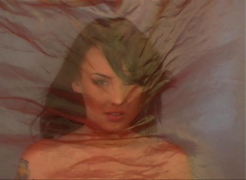 Beautiful Brunette Behind Sheer Fabric (1) Stock Video Footage