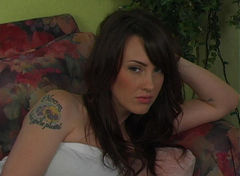 Beautiful, Sexy Tattooed Brunette Lying on her Flo Footage