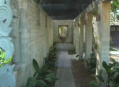 Ghostly Woman in an Outdoor Covered Walkway Footage