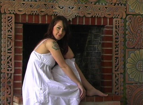 Beautiful Girl Sitting at a Fireplace (4) Stock Video Footage