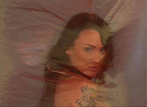 Beautiful Brunette Behind Sheer Fabric (2) Stock Video Footage