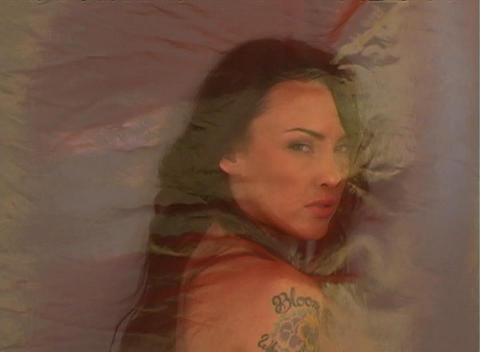 Beautiful Brunette Behind Sheer Fabric (2) Stock Video Footage