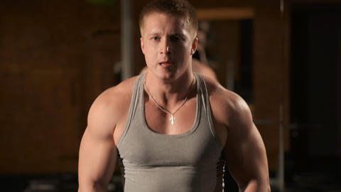 Healthy muscular young man engaged in bodybuildin Stock Video Footage