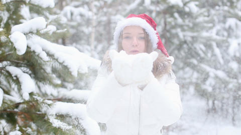 Happy Friendly Woman Blowing Snowflakes Stock Video Footage