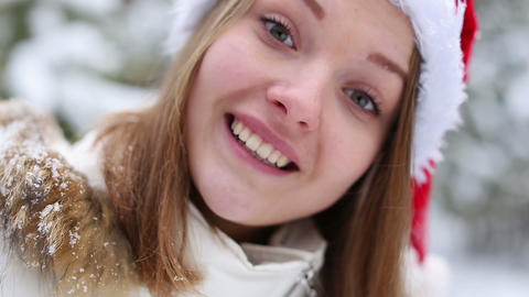 Cheerful woman in a cap of Santa Claus Stock Video Footage