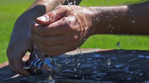 Washing Hands in the Drinking Fountain Stock Video Footage