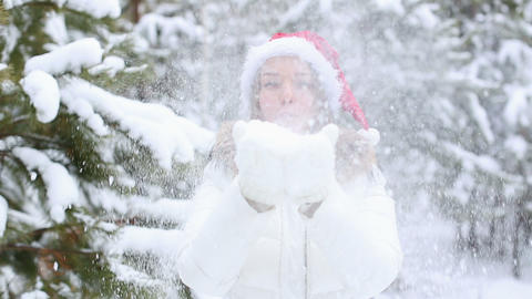 Friendly Woman Blowing Snowflakes Stock Video Footage
