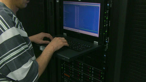 Man working in server room Stock Video Footage