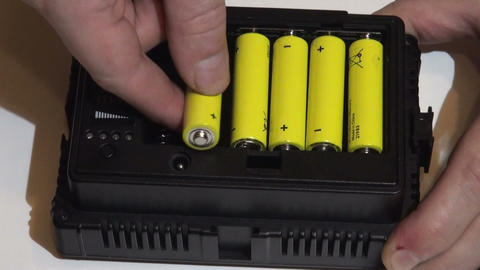 Install the batteries in the flashlight Stock Video Footage