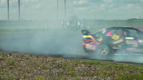 Auto Racing. The Smoke From Under The Tires stock footage