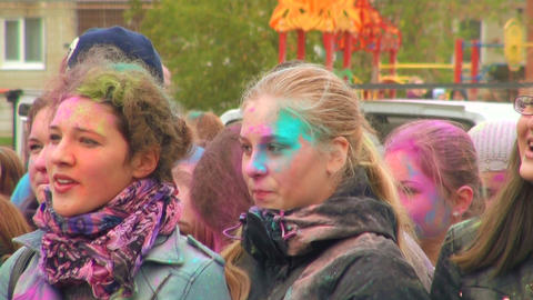 The faces of the people in the colored paints Stock Video Footage
