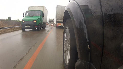 A dense stream of cars on the highway Stock Video Footage