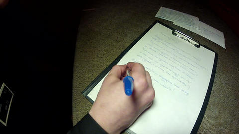 A convicted criminal writes a letter Stock Video Footage