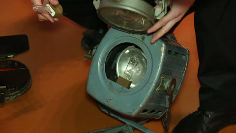 Replacing burnt out lamp in the spotlight Stock Video Footage