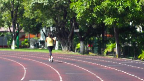 Running the stadium track Stock Video Footage