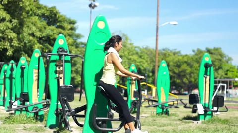Young Woman Using An Exercise Machine stock footage