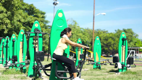 Young woman using an Exercise machine Stock Video Footage