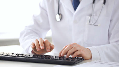 male doctor hands typing on keyboard Stock Video Footage