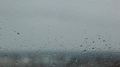 grey rainy glass with water drops Stock Video Footage