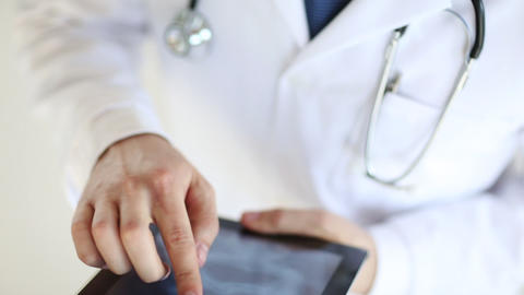doctor working with x-ray scan on tablet pc Stock Video Footage
