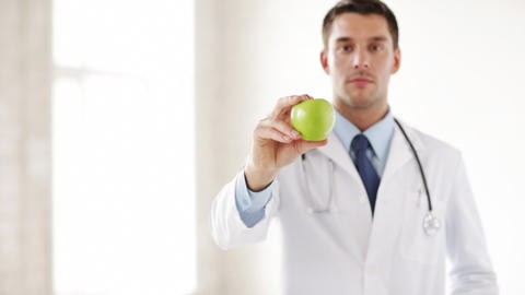 doctor with green apple in hands Stock Video Footage