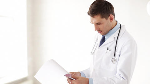 male doctor making a prescription Stock Video Footage