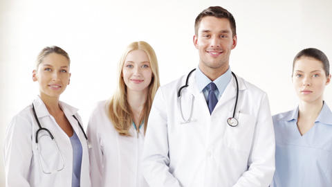 Group Of Smiling Doctors stock footage