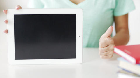 woman showing something on tablet pc screen Stock Video Footage