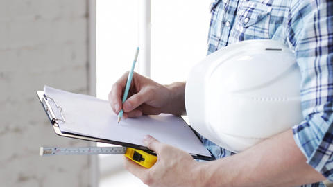 builder with measuring tape on site Stock Video Footage