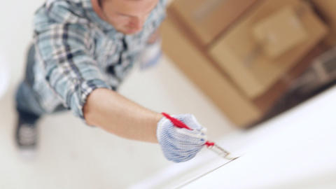 man painting with white paint Stock Video Footage
