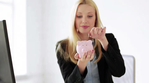 business woman with piggy bank and money Footage