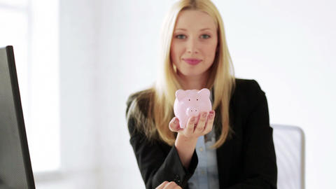 business woman with piggy bank and money Stock Video Footage
