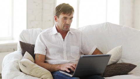 man working with laptop at home Stock Video Footage