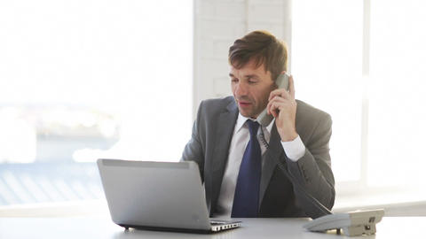 businessman with laptop computer and phone Stock Video Footage